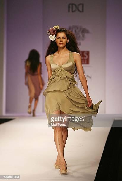 Neha Kapur walks the ramp for designer Shreya Sharma on the third day of the Wills Lifestyle India Fashion Week in New Delhi on October 25 2010