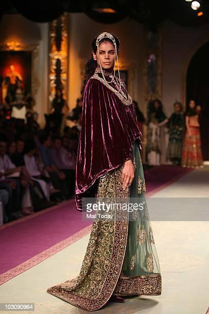 Neha Kapur walks the ramp for designer Varun Bahl on Day V of the Delhi Couture Week on July 24 2010