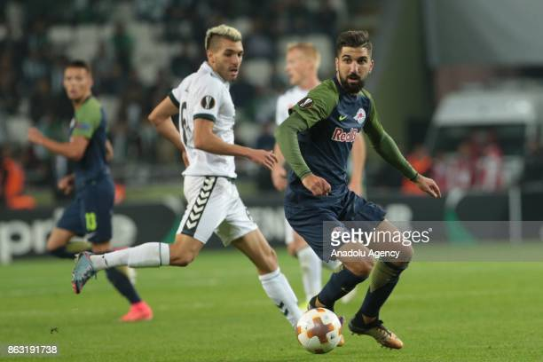 Nehdi Bourabia of Atiker Konyaspor in action against Munas Dabbur of Salzburg during the UEFA Europa League Group I soccer match between Atiker...