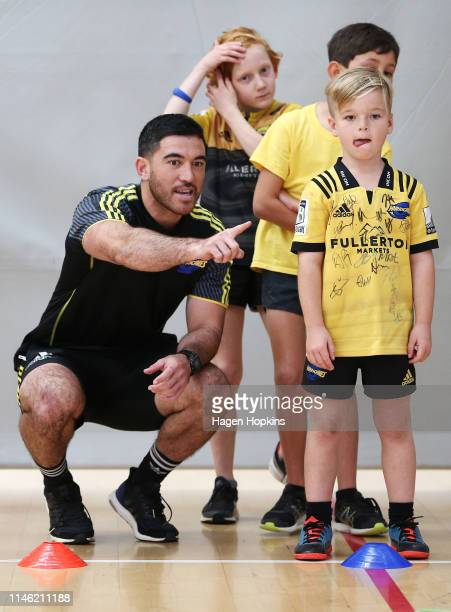 Nehe Milner-Skudder interacts with children during a Hurricanes Kids Coaching Clinic at ASB Sports Centre on May 01, 2019 in Wellington, New Zealand.