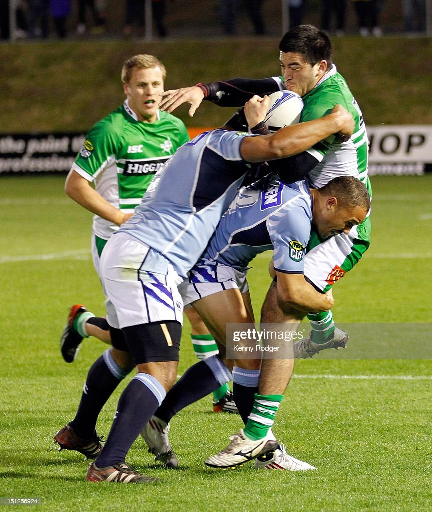 Nehe Milner-Skudder of Manawatu is hit hard by the Northland defence during the round four ITM Cup match between Northland and Manawatu at Toll Stadium on September 5, 2012 in Whangarei, New Zealand.