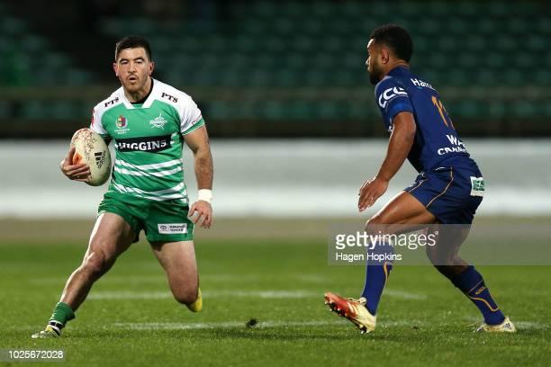Nehe Milner-Skudder of Manawatu looks to evade Jona Nareki of Otago during the round three Mitre 10 Cup match between Manawatu and Otago at Central...