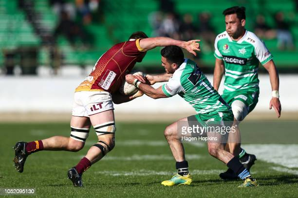 Nehe MilnerSkudder of Manawatu tackles Phil Halder of Southland during the round nine Mitre 10 Cup match between Manawatu and Southland at Central...
