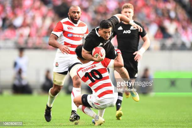 Nehe Milner-Skudder of the All Blacks is tackled by Yu Tamura of Japan during the test match between Japan and New Zealand All Blacks at Tokyo...