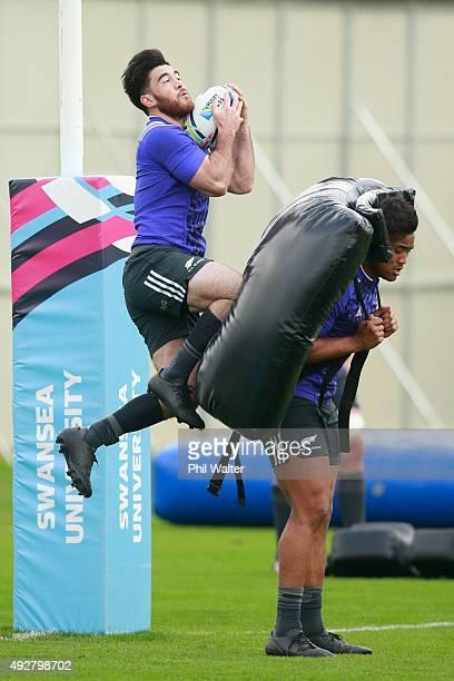 Nehe Milner-Skudder of the All Blacks leaps over Julian Savea during a New Zealand All Blacks training session at Swansea University on October 15,...