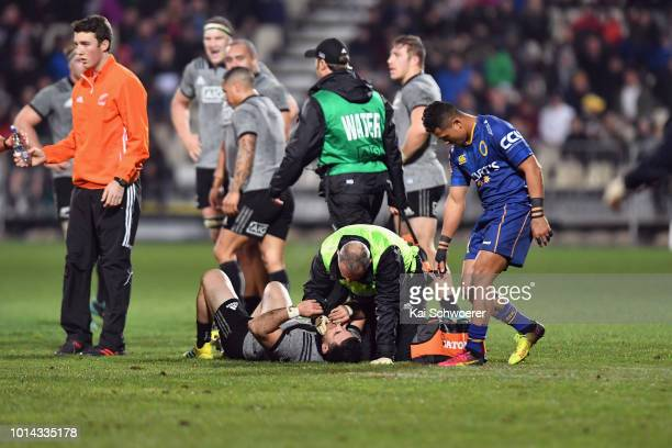 Nehe MilnerSkudder of the All Blacks receives medical help during the Game of Three Halves between the New Zealand All Blacks and Otago at AMI...