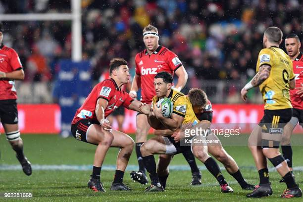 Nehe MilnerSkudder of the Hurricanes is tackled during the round 15 Super Rugby match between the Crusaders and the Hurricanes at AMI Stadium on May...
