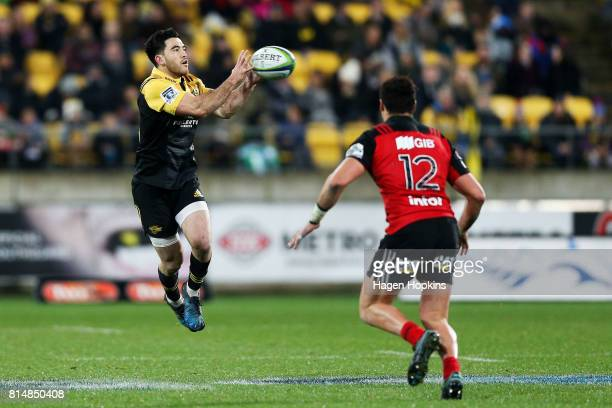 Nehe MilnerSkudder of the Hurricanes receives a pass under pressure from David Havili of the Crusaders during the round 17 Super Rugby match between...