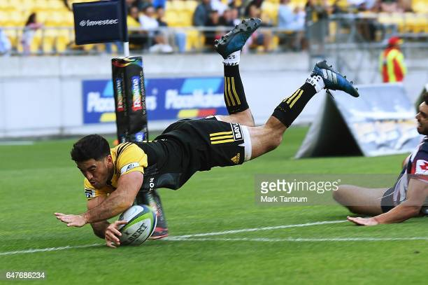 Nehe Milner-Skudder of the Hurricanes scores during the round two Super Rugby match between the Hurricanes and the Rebels at Westpac Stadium on March...