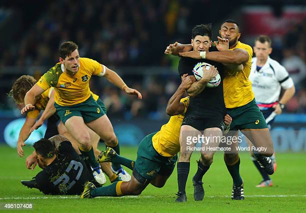 Nehe Milner-Skudder of the New Zealand All Blacks is wrapped up by Sekope Kepu of Australia during the 2015 Rugby World Cup Final match between New...