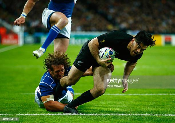 Nehe MilnerSkudder of the New Zealand All Blacks scores his teams second try despite a tackle by Jacques Burger of Namibia during the 2015 Rugby...