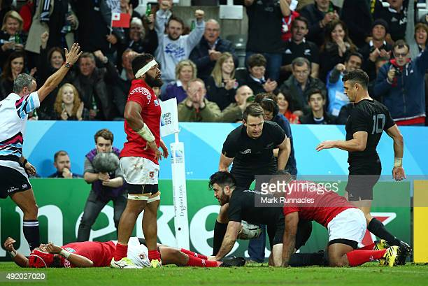 Nehe Milner-Skudder of the New Zealand All Blacks scores their third try during the 2015 Rugby World Cup Pool C match between New Zealand and Tonga...
