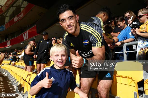 Nehe MilnerSkudder poses with a fan during a Hurricanes Super Rugby Captain's Run at Westpac Stadium on April 26 2018 in Wellington New Zealand