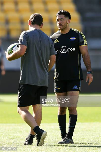 Nehe MilnerSkudder talks to assistant coach Jason Holland of the Hurricanes during a Hurricanes Super Rugby Captain's Run at Westpac Stadium on April...