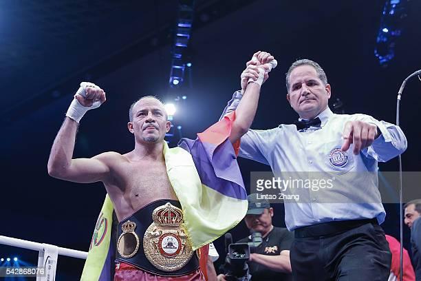 Nehomar Cermeno of Venezuela celebrates his victory over Qiu Xiaojun of China during their WBA world super bantamweight championship belt match at...