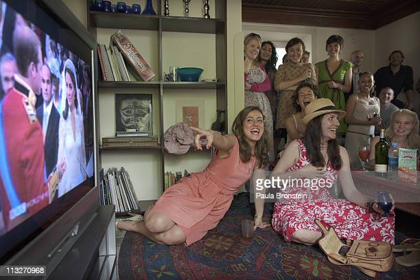 Nehrnoosh Aryanpour and Nina Brantley watch the royal wedding of Prince William to Catherine Middleton on television April 29 2011 in Kabul...