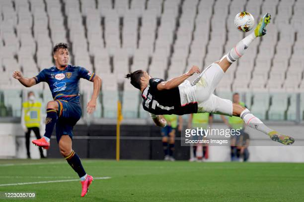 Nehuen Paz of Lecce, Cristiano Ronaldo of Juventus during the Italian Serie A match between Juventus v Lecce at the Allianz Stadium on June 26, 2020...