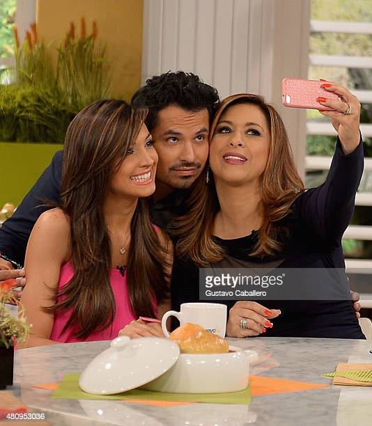 Neida Sandoval and Michael Pena take a selfie on set of Uno Nuevo Dia to promote AntMan at Telemundo Studio on July 16 2015 in Miami Florida