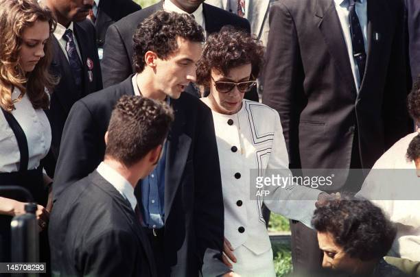 Neide Senna mother of Formula One driver Ayrton Senna is accompagnied by her son Leonardo on May 05 during the funeral of Ayrton Senna in Sao Paulo...