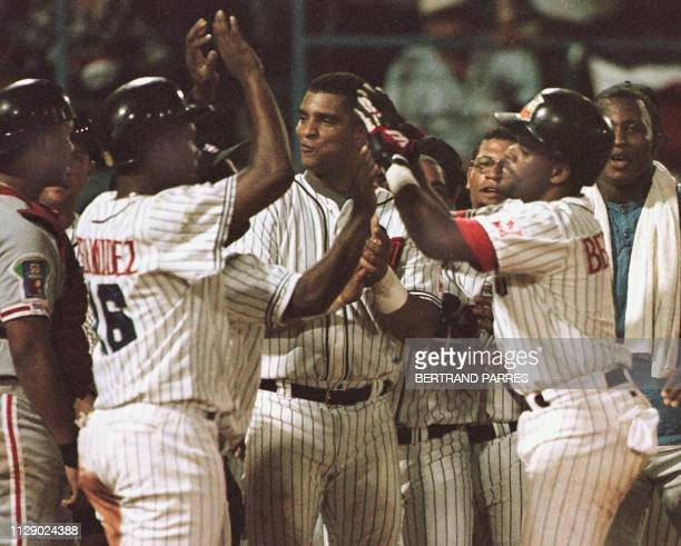 Neifi Perez de Republica Dominicana es saludado por sus companeros de equipo luego de batear de homerun en el tercer inning del juego contra...