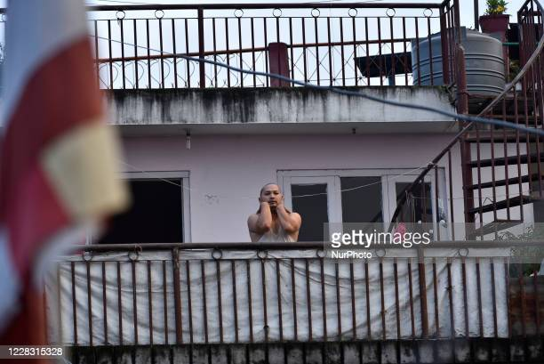 Neighbor of RAJMAN MAHARJAN join in practicing Yoga Positions in the roof of house after the three district administrations have enforced prohibitory...