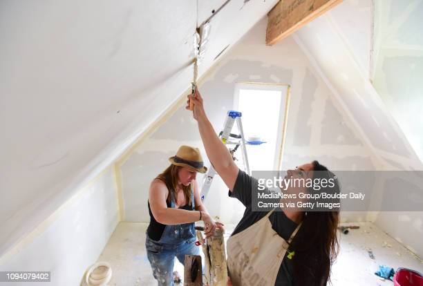 Neighbor Terri Maples right and homeowner Jessica Augustus work on drywall during a remodel of a 100 plus year old barn on the 900 Block of Alta...