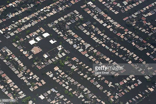 Neighborhood east of downtown New Orleans remains flooded August 30, 2005 in New Orleans, Louisiana. Approximately 100 people are feared dead and...