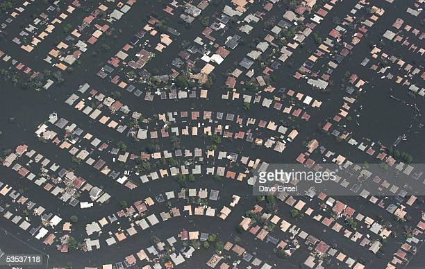 A neighborhood east of downtown New Orleans remains flooded August 30 2005 in flight over Louisiana Approximately 100 people are feared dead and...