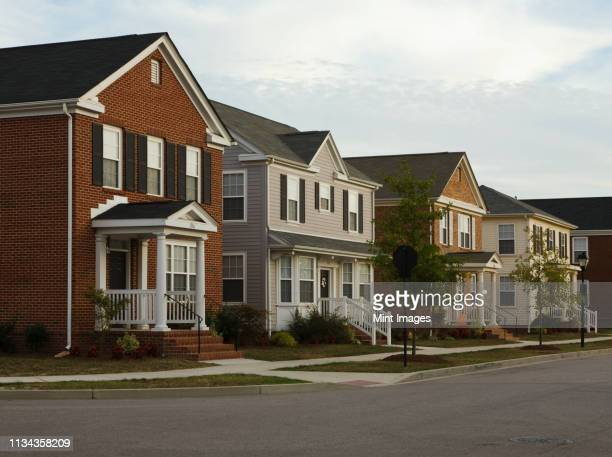 neighborhood homes on street corner - residential district stock pictures, royalty-free photos & images