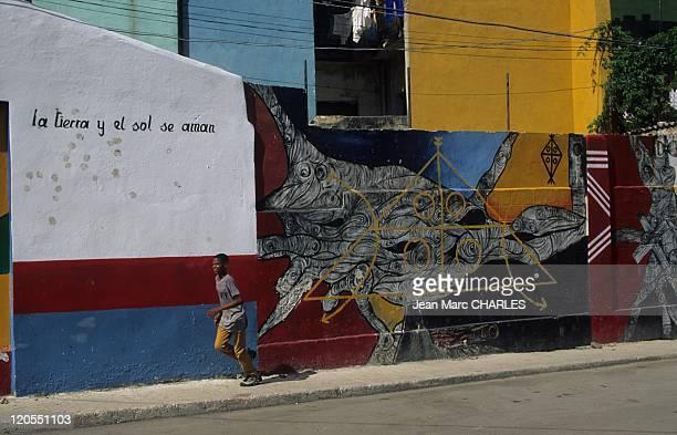 Neighborhood in Havana Cuba Callejon de Hamel The earth and the sun are in love Salvador Escalona naive universe
