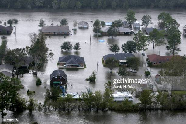 A neighborhood is seen flooded after Hurricane Rita September 24 2005 in Dularge Louisiana Hurricane Rita caused massive damage as it moved across...
