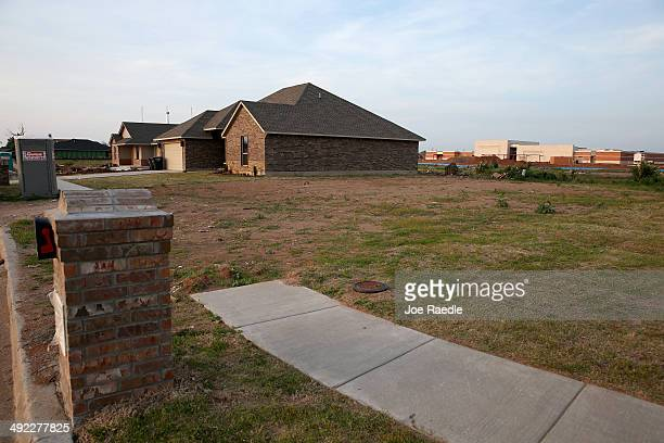 A neighborhood is seen one year after all the homes were destroyed by a tornado on May 18 2014 in Moore Oklahoma On May 20 2013 a twomile wide EF5...