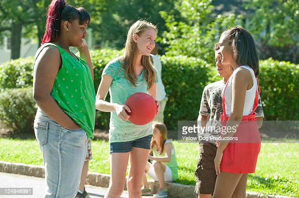 neighborhood kids playing kickball - kickball stock photos and pictures