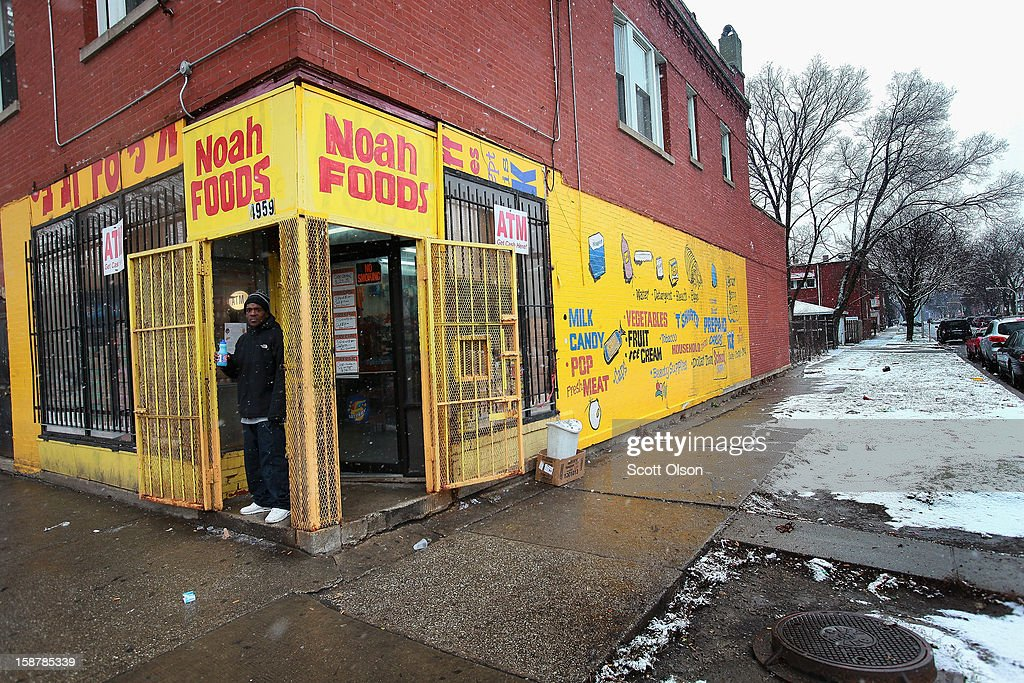 A neighborhood resident stands in front of Noah Foods December 28, 2012 in Chicago, Illinois. Nathaniel Jackson, believed to be the 500th murder victim of the year in Chicago, was shot in the head and killed outside the store on December 27. After news organizations began reporting about his murder, the Chicago Police Department's News Affairs Office issued a statement stating Chicago's murder total remains at 499 because classification of one death investigation remains pending. They would not specify which death is pending. The total number of murders in the city has only once exceeded 500 victims since 2004. The murder rate is up about 11 percent from 2011, much of which is attributed to growing gang violence.