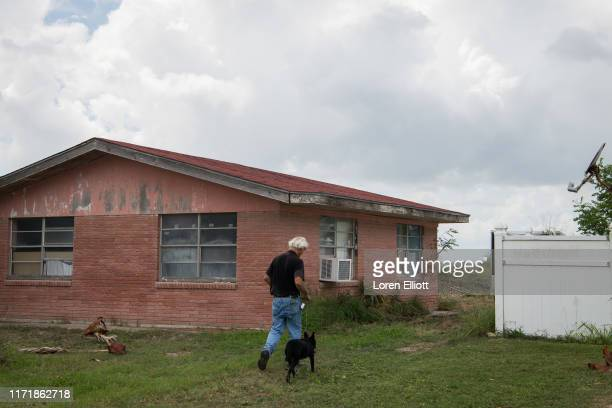 Neighborhood resident walks his dog in Boca Chica Village on September 28, 2019 in Boca Chica near Brownsville, Texas. SpaceX is attempting to buy...