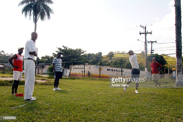 Neighborhood residents play golf May 14 2003 at Japeri Municipal Public Golf Course in Rio de Janeiro suburb of Japeri The golf course was a cow...