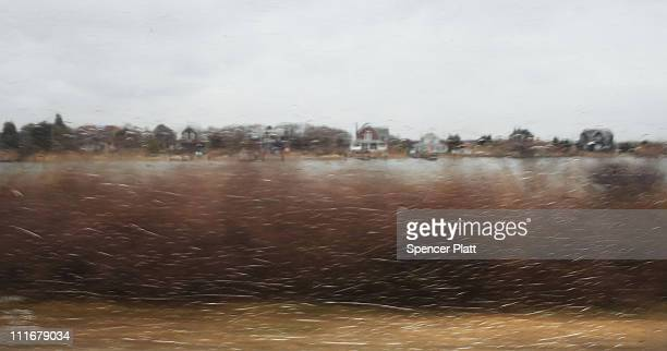 A neighborhood seen through a bus window along a stretch of beach highway where police recently found human remains on April 5 2011 in Babylon New...