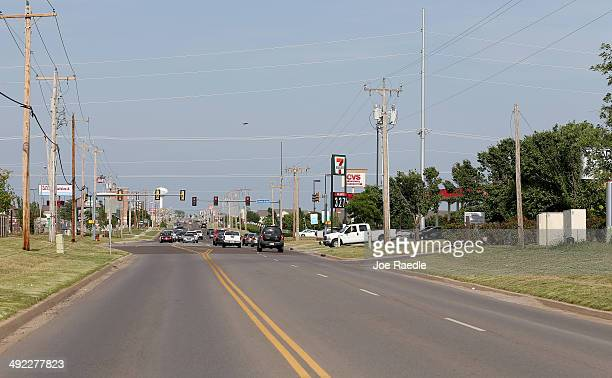 A neighborhood street is seen one year after it was unpassable because of downed powerlines and trees after a tornado hit on May 18 2014 in Moore...