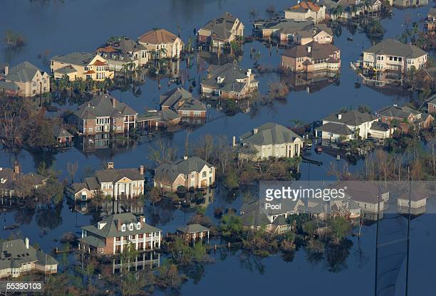 Neighborhoods are flooded with oil and water two weeks after Hurricane Katrina went though Louisiana September 12 2005 in New Orleans Louisiana US...