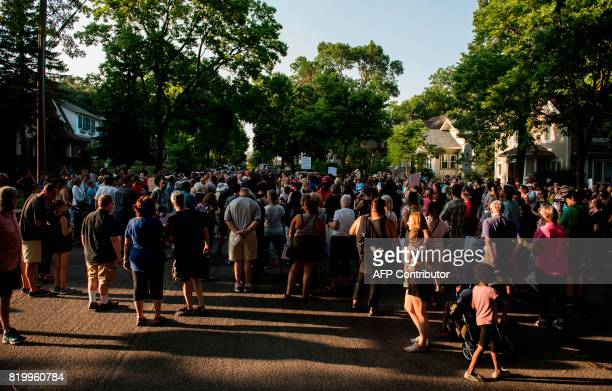 Neighbors and community members gather on the block where Justine Damond was shot on July 20 2017 in Minneapolis Minnesota Several days of...