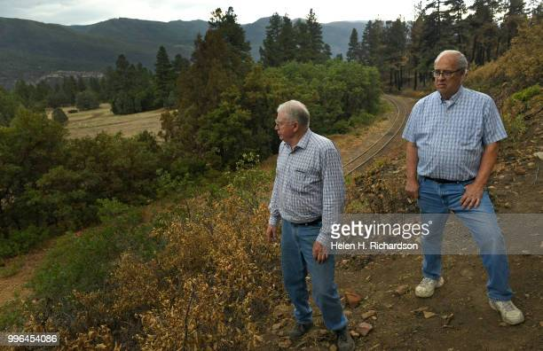 Neighbors Cres Fleming left and Al Chione right stand in the exact area where he says the 416 fire started on July 10 2018 near Hermosa Colorado...
