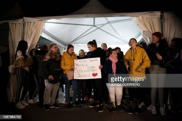 Neighbors gather in support of twoyearold Julen Rosello and his parents in Totalan southern Spain on January 24 2019 Miners were lowered on a cage to...