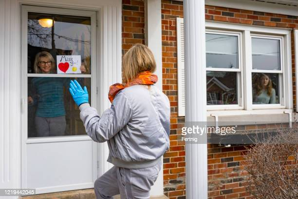 neighbors helping each other.  a friend drops by for a chat on the doorstep. - waving stock pictures, royalty-free photos & images