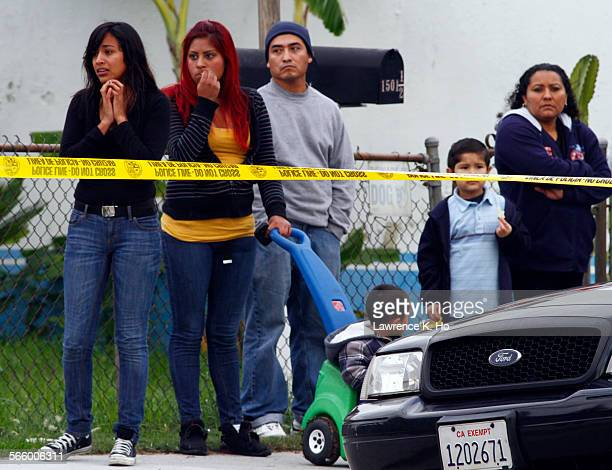 Neighbors in the area watching in sadness as LAPD investigators at the scene of a fatal shooting incident on Caesar Chavez Blvd and Warren St in...