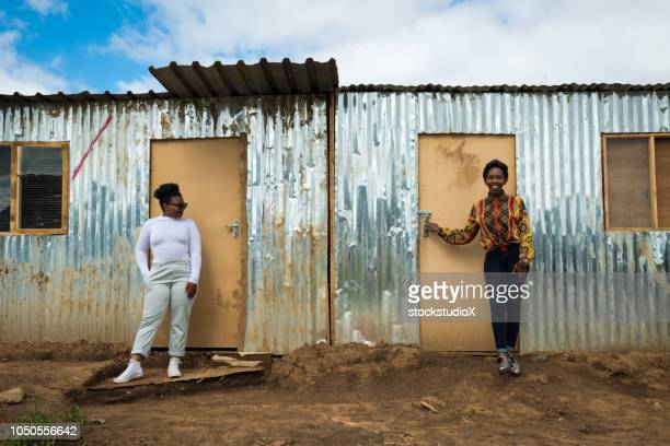 neighbors in the townships of africa - black alley stock photos and pictures