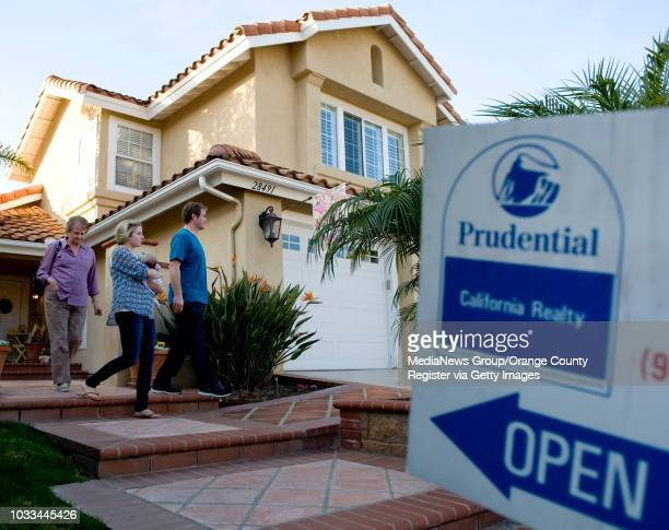 Neighbors leave an open house on Rancho Grande in Laguna Niguel. The city had 1,210 home sales last year, most for any Orange County ZIP code....