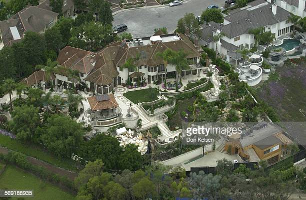 Neighbors of Broadcom's Henry Nicholas say they are fed up with the massive construction going on at his Nellie Gail Mansion situated on the hill...