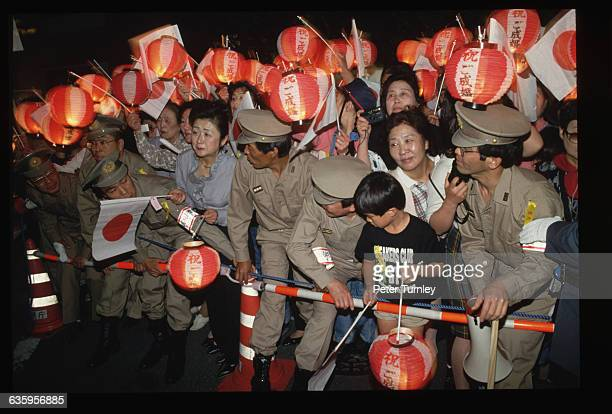 Neighbors of Masako Owada's family gather outside its home on June 8 the night before Masako's marriage to Crown Prince Naruhito