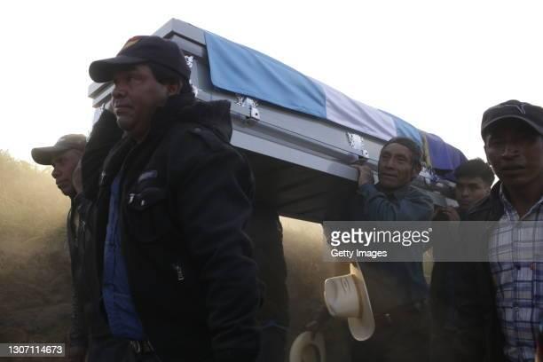 Neighbors of Rivaldo Danilo Jimenez carrying his coffin on March 14, 2021 in Comitancillo, Guatemala. 19 shot and charred bodies were found in two...