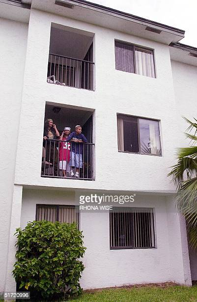 Neighbors of suspected terrorist Mohamed Atta watch the media above the first floor apartment of Atta's last know address in Coral Springs Florida 12...